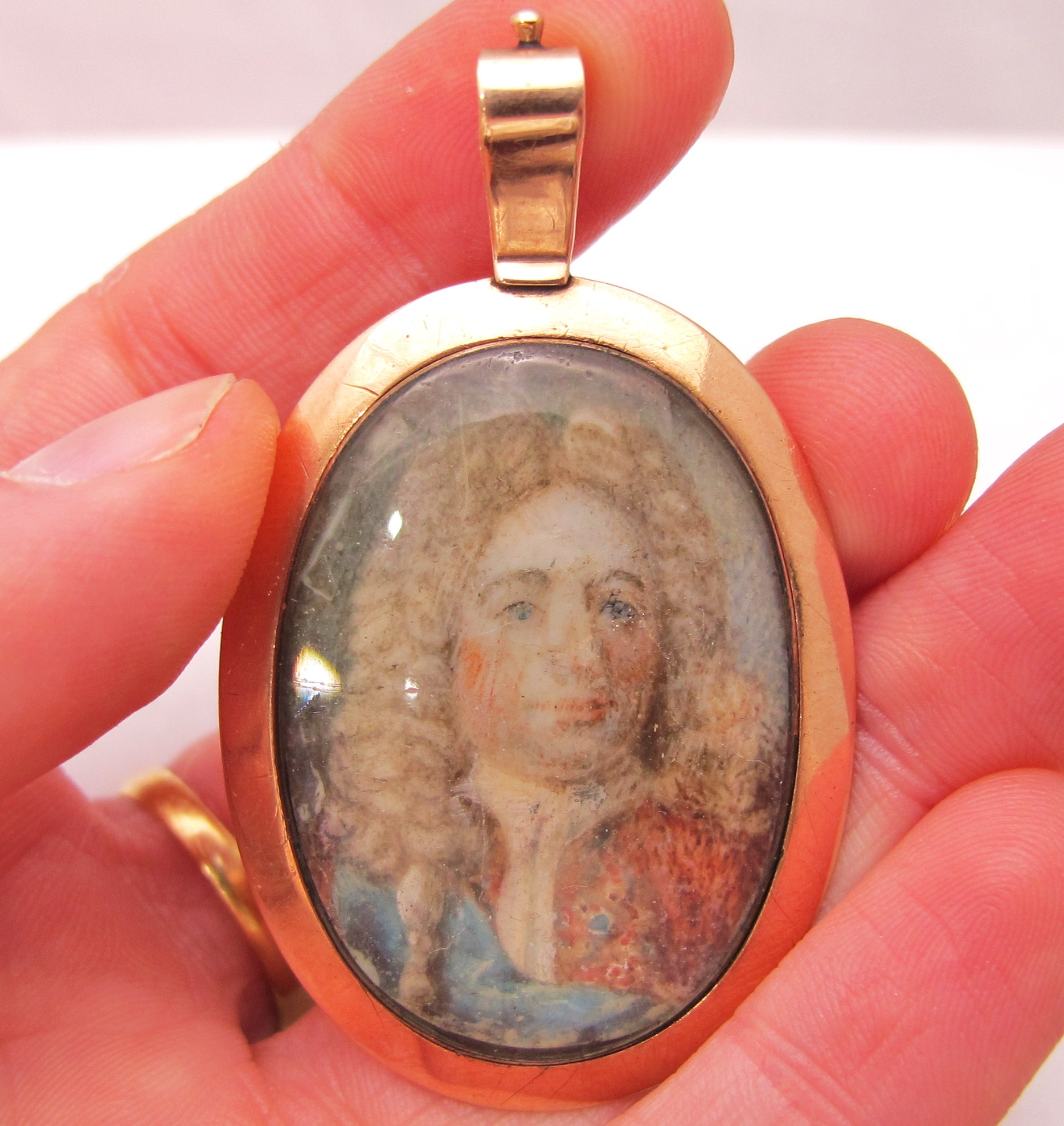 12k gold, painted miniature. Painting c 1600s, frame c. 1700s