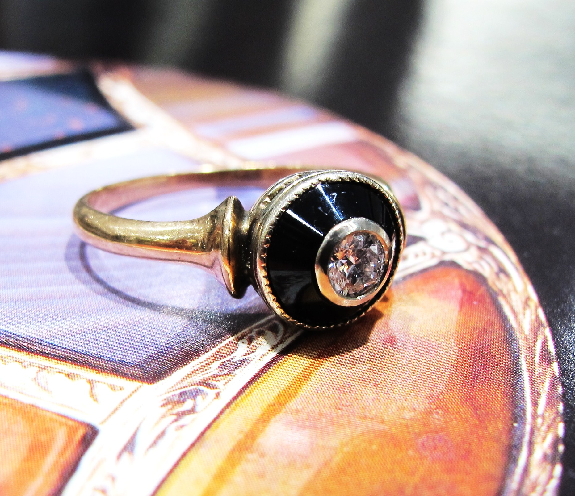 10k gold, onyx, .15ct old European cut diamond, c. late Victorian era