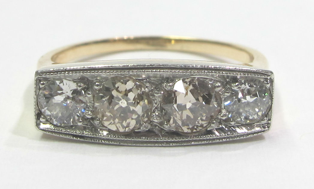 Late Victorian 14k gold and platinum ring with four diamonds totaling 1.80cts of diamonds, at Gray & Davis. Color ranges K-P, and contributes to the overall design of the ring.