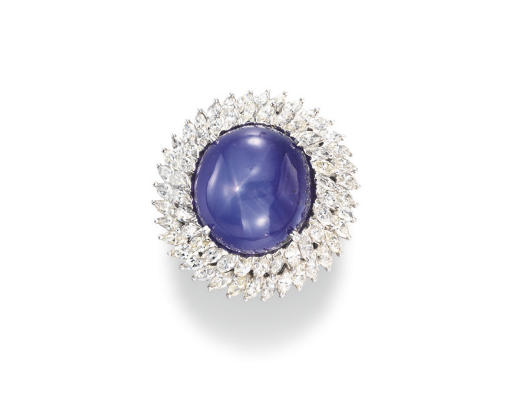 From Christie's:  Set with a cabochon star sapphire within a two-tiered marquise-cut diamond surround, mounted in platinum,