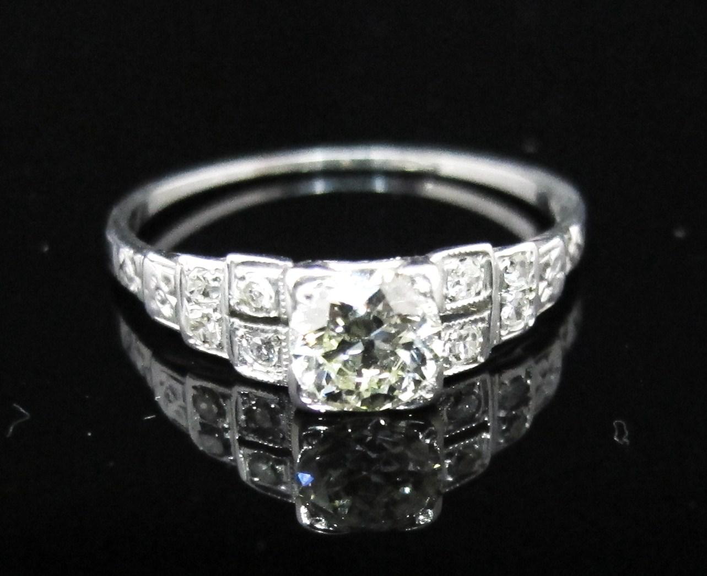 18k white gold with .53ct L color, VS2 clarity old European cut center diamond and eight single-cut accent diamonds. Art Deco, c.1925.