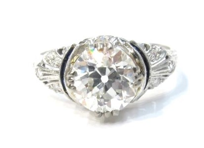 1.91ct H/I color, VS2 clarity old European cut diamond in platinum, sapphire and diamond setting. c.1920