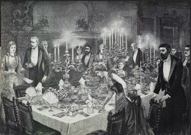 An Edwardian dinner party, bathed in candlelight.