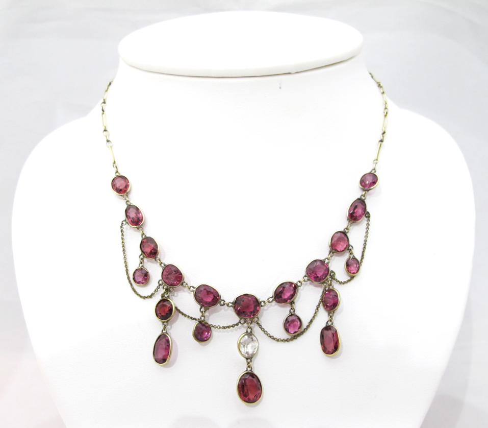Victorian gold and garnet festoon necklace. Available at Gray & Davis.