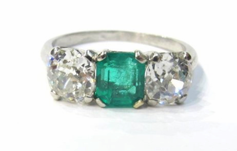 Platinum setting with 0.93ct square emerald cut emerald and two H/SI1 old mine cut diamonds. Total diamond carat weight is 1.76cts. C. 1920s - 1930s, available at Gray & Davis.