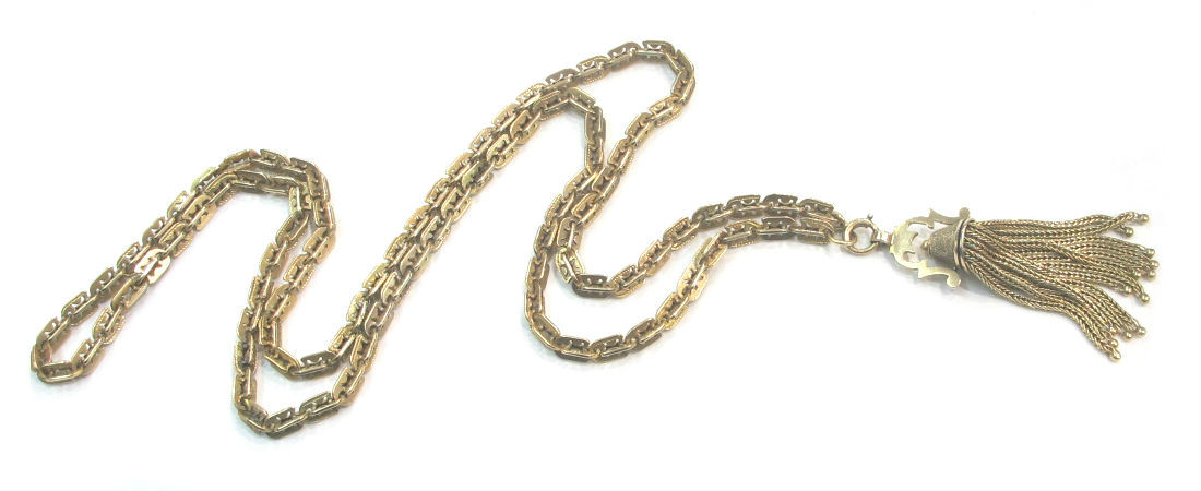Late Victorian 10k gold tassel necklace with black enamel and stippled detail. Available at Gray & Davis.