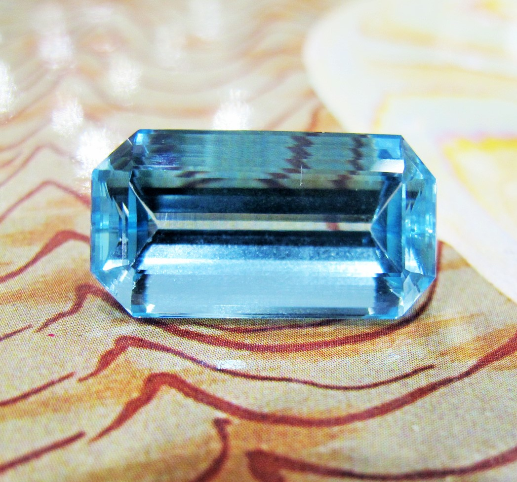 Rectangular step-cut aquamarine, weighing approx 25 carats.