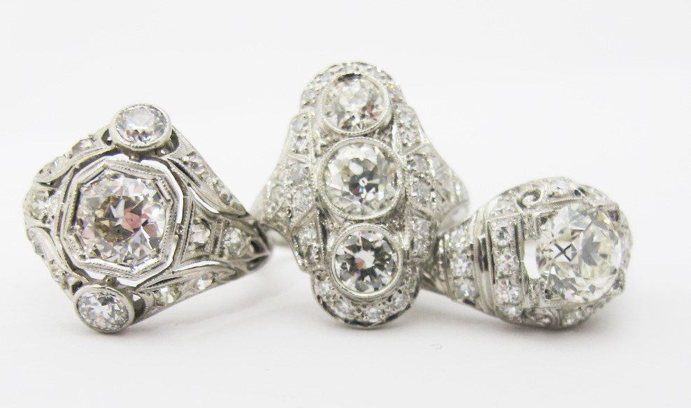 Three platinum and diamond rings, c. early 20th century. All available for sale at Gray & Davis.
