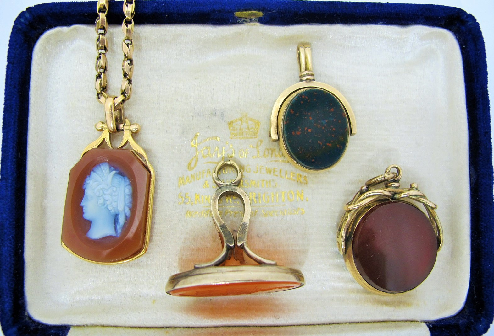 Four nineteenth-century watch fobs, from left to right: Reversible sardonyx cameo in 14k gold, carnelian seal intaglio in 10k gold, carnelian and bloodstone swivel-fob in 10k gold, carnelian and bloodstone swivel-fob in 9k gold. All available for sale at Gray & Davis.