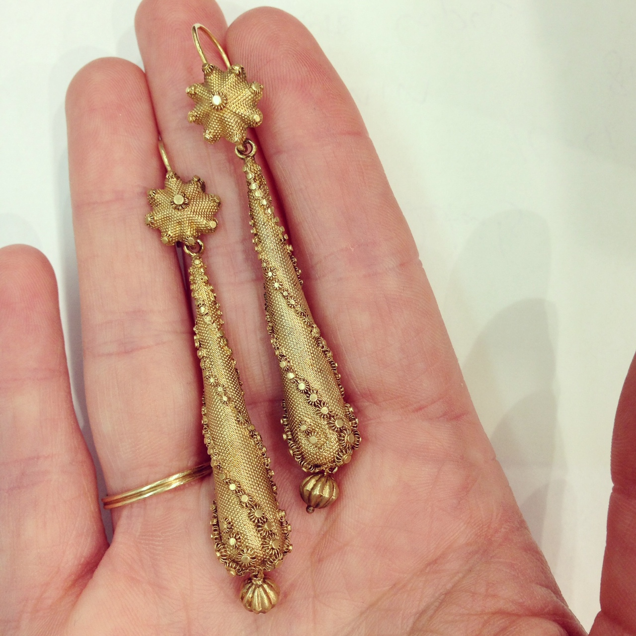 "Georgian ""torpedo"" earrings in 15k yellow gold with cannetille rosettes and fluted dangles. c. 1830. Available for sale at Gray & Davis."