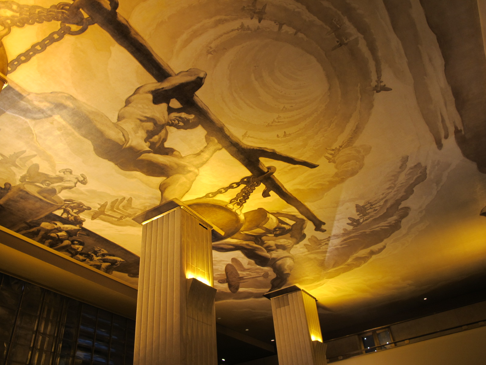 Time -  by Jose Maria Sert. A dramatic mural on the ceiling of 30 Rockefeller Center depicts a giant Titan bracing his weight between two columns that symbolize the past and the future. Whether he is leaning towards the past or the future depends on your perspective as you move about the  lobby.