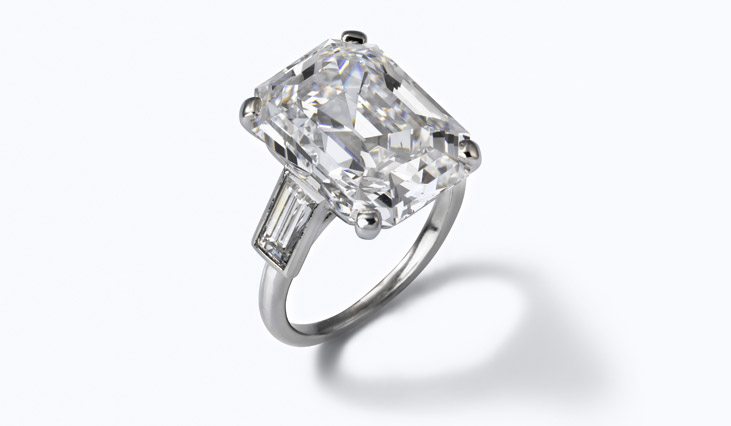 Engagement ring #2: a 10.47 carat emerald cut diamond with baguette accents in a platinum setting, also by Cartier.
