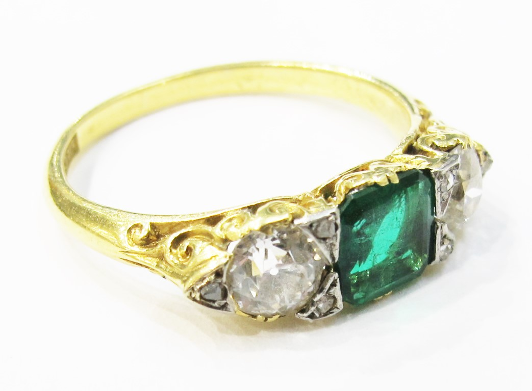 Victorian emerald & diamond ring with scrollwork detailing.