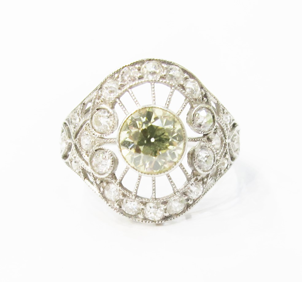 Edwardian ring with platinum filigree and white & yellow diamonds.