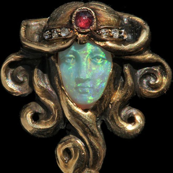 Art Nouveau stick pin with carved opal face by Wilhelm Lucas von Cranach. c. 1900. Currently in the collection of the   Pforzheim Schmuckmuseum  in Germany.