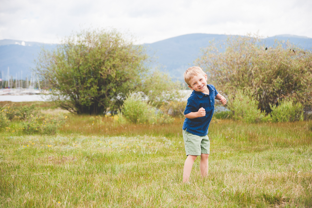 A young boy goofs around and acts silly in between other family shots at their Lake Dillon, Colorado family photo shoot.