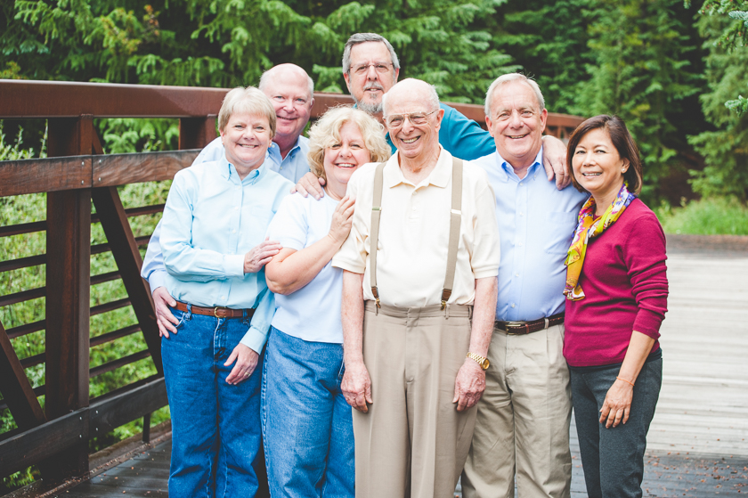 Dad and his children and their spouses gather close for a sweet family photo during vacation at Copper Mountain Resort.