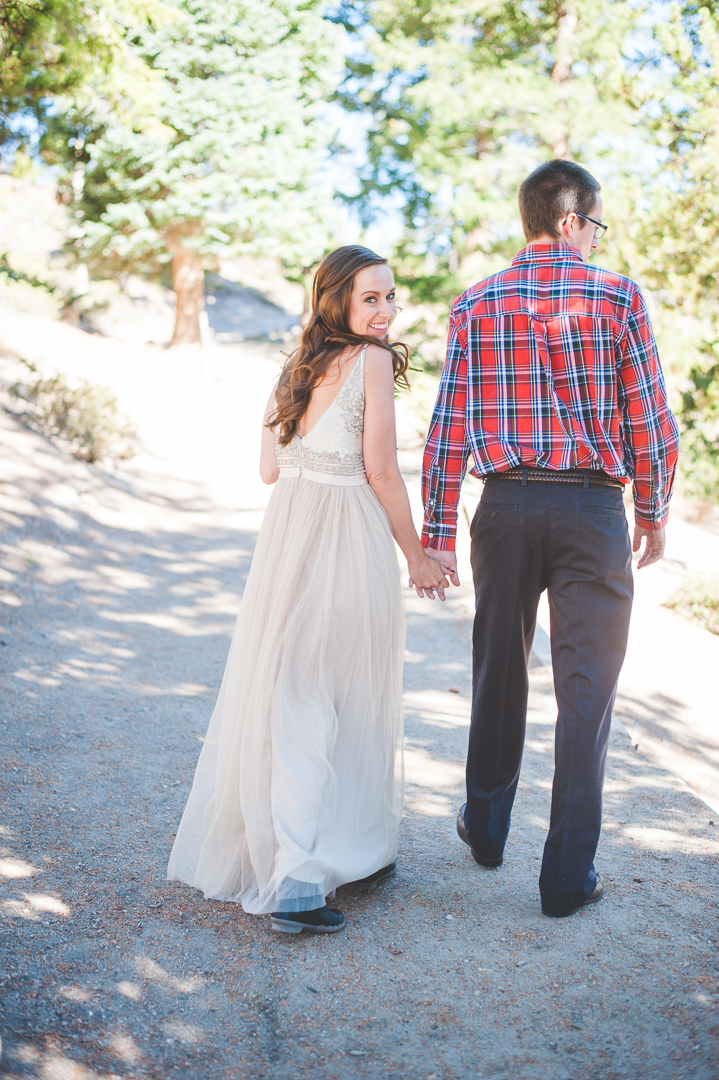 A quick glance over her shoulder as she and her groom leave their elopement ceremony site at Sapphire Point. |Keeping Composure Photography