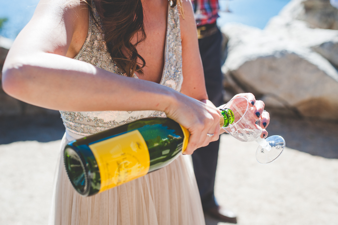 This bride came prepared with disposable champagne glasses for their post-elopement celebration! | Keeping Composure Photography