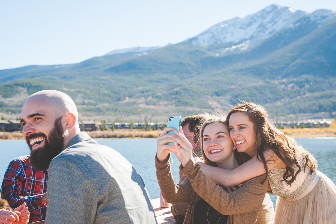 A Colorado bride captures the moment with her best friend, making sure the mountains are in the background. |Keeping Composure Photography