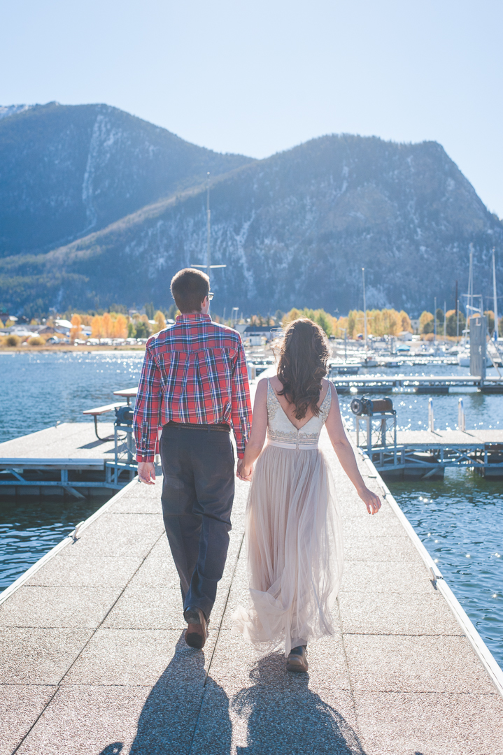 """Late afternoon """"magic hour"""" light floods the docks of at the Frisco Marina as this newly-wed Bride and Groom head off to their next great adventure together! 