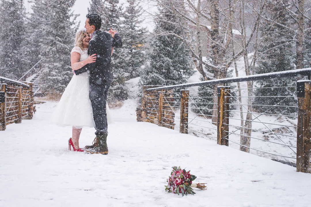 A winter elopement in Breckenridge, Colorado under falling snow, with red accents that pop! | Keeping Composure Photography