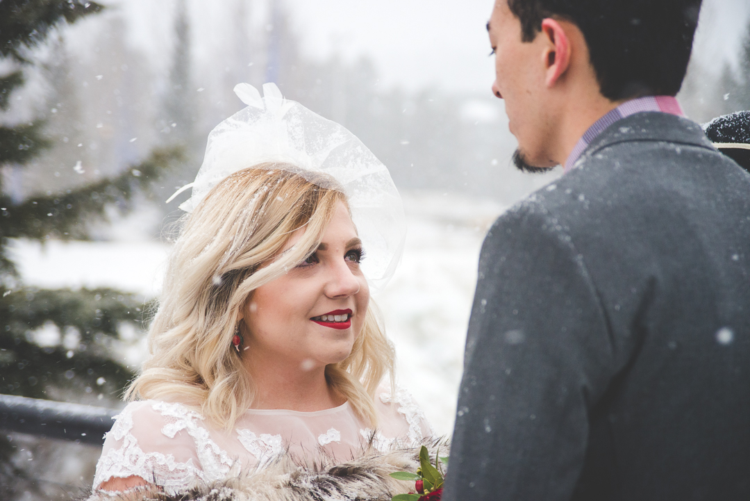 A snowy mountain elopement in the middle of winter, in the heart of Breckenridge, Colorado | Red wedding accents that pop in the white snow | Keeping Composure Photography