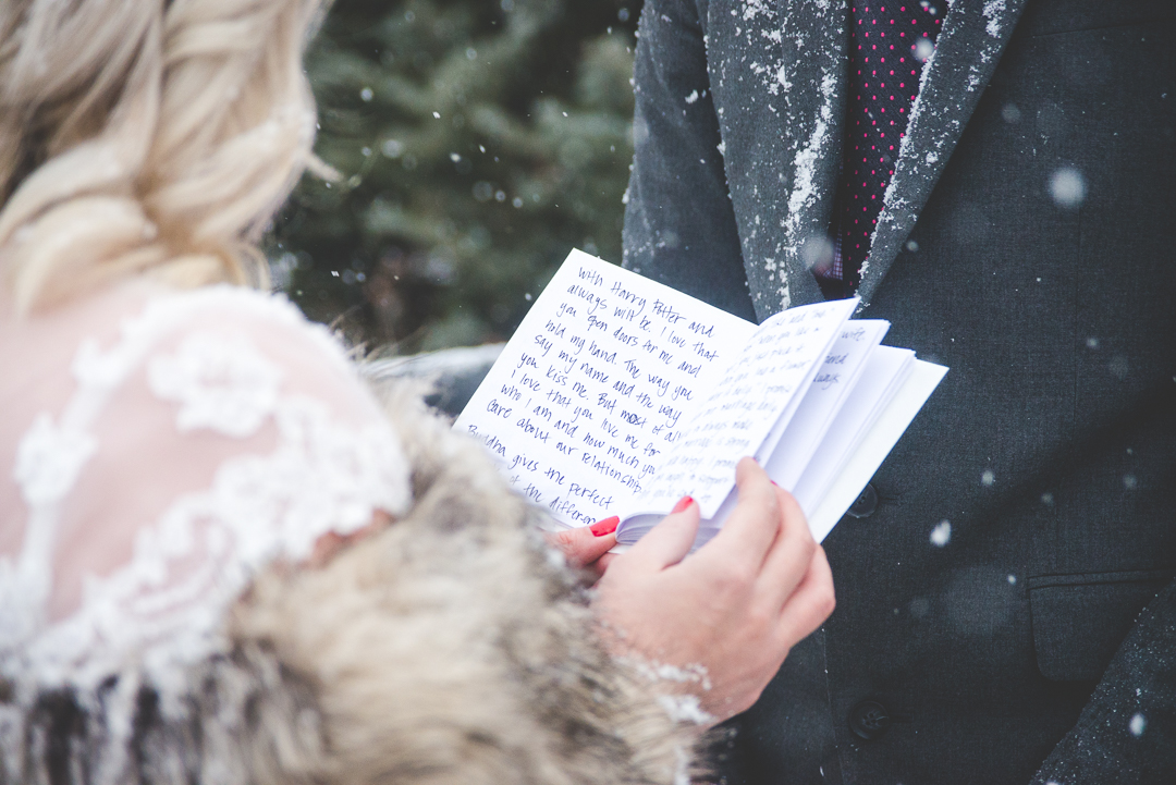Red accents pop in this romantic and intimate winter elopement in Breckenridge, Colorado, under the falling snow. | Keeping Composure Photography