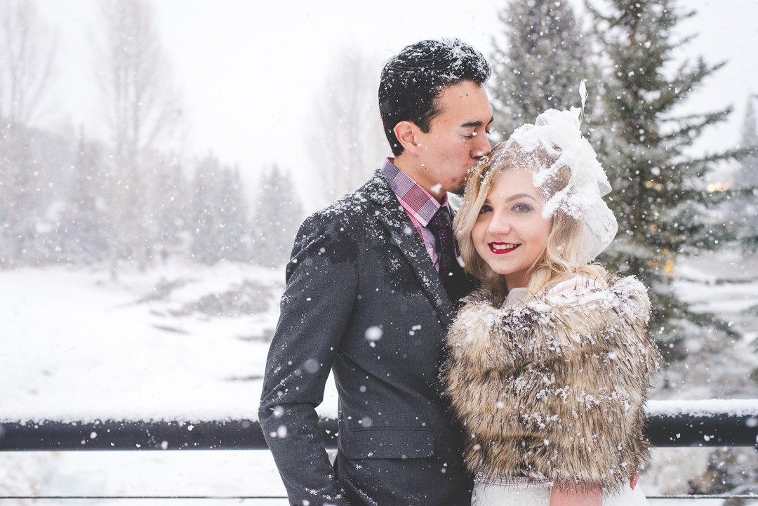 This Colorado bride and groom braved the pounding snow for their winter elopement in Breckenridge - how far would you go for the perfect wedding photos? Worth it. | Keeping Composure Photography