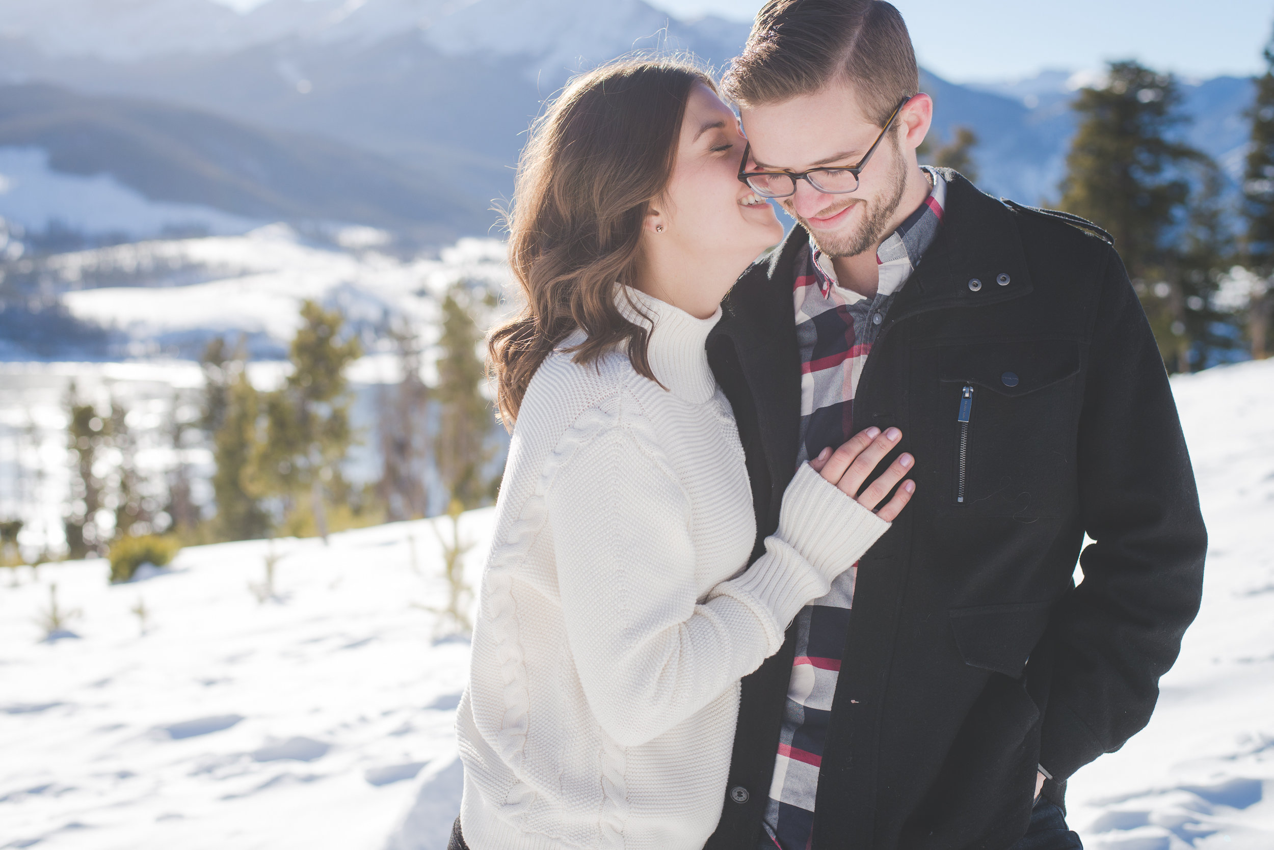 a sweet, romantic moment between engaged couple during their winter mountain engagement shoot in colorado. sapphire point is the perfect location for destination engagement photos!