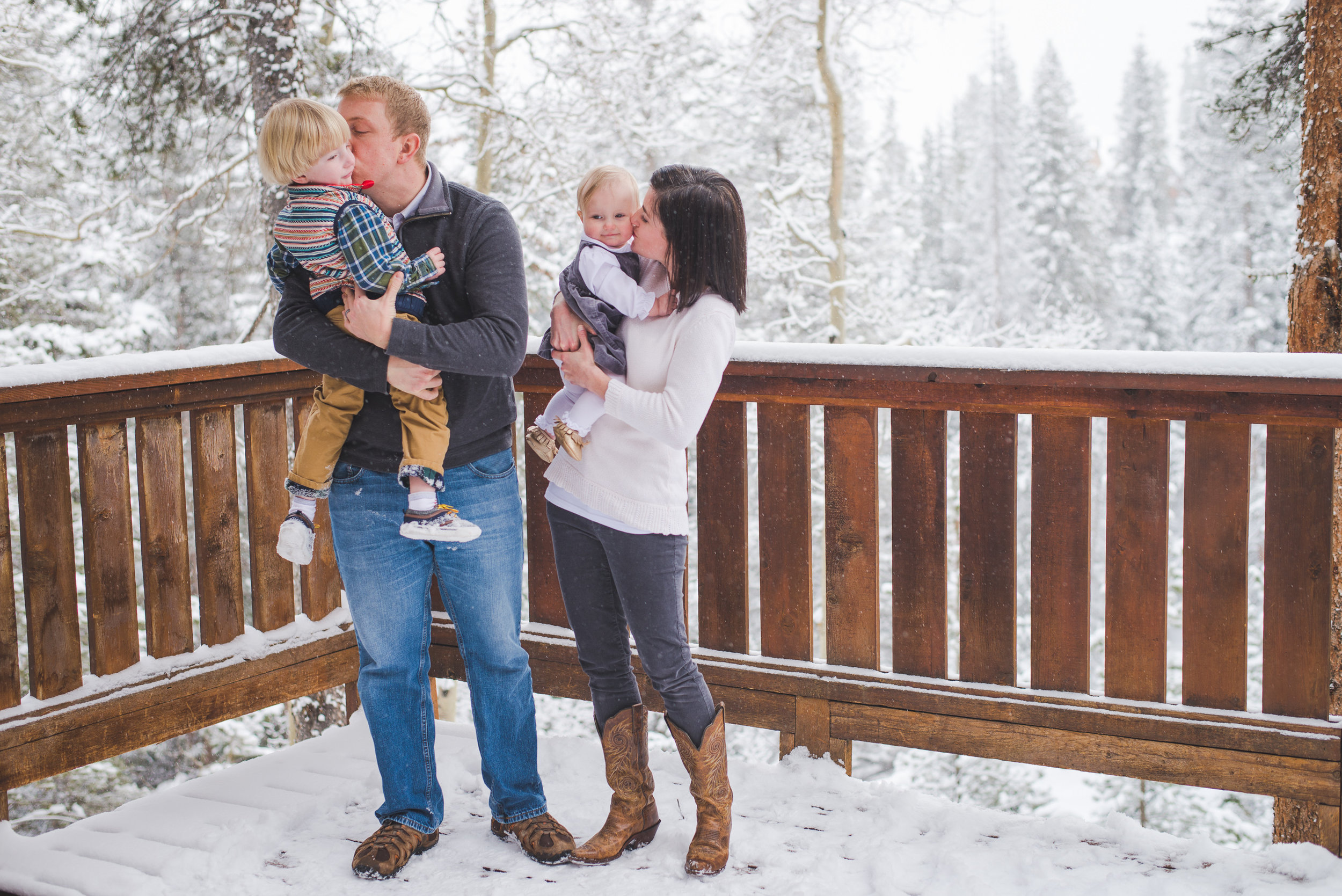Kisses for the kids during their winter family photo shoot in Breckenridge, Colorado