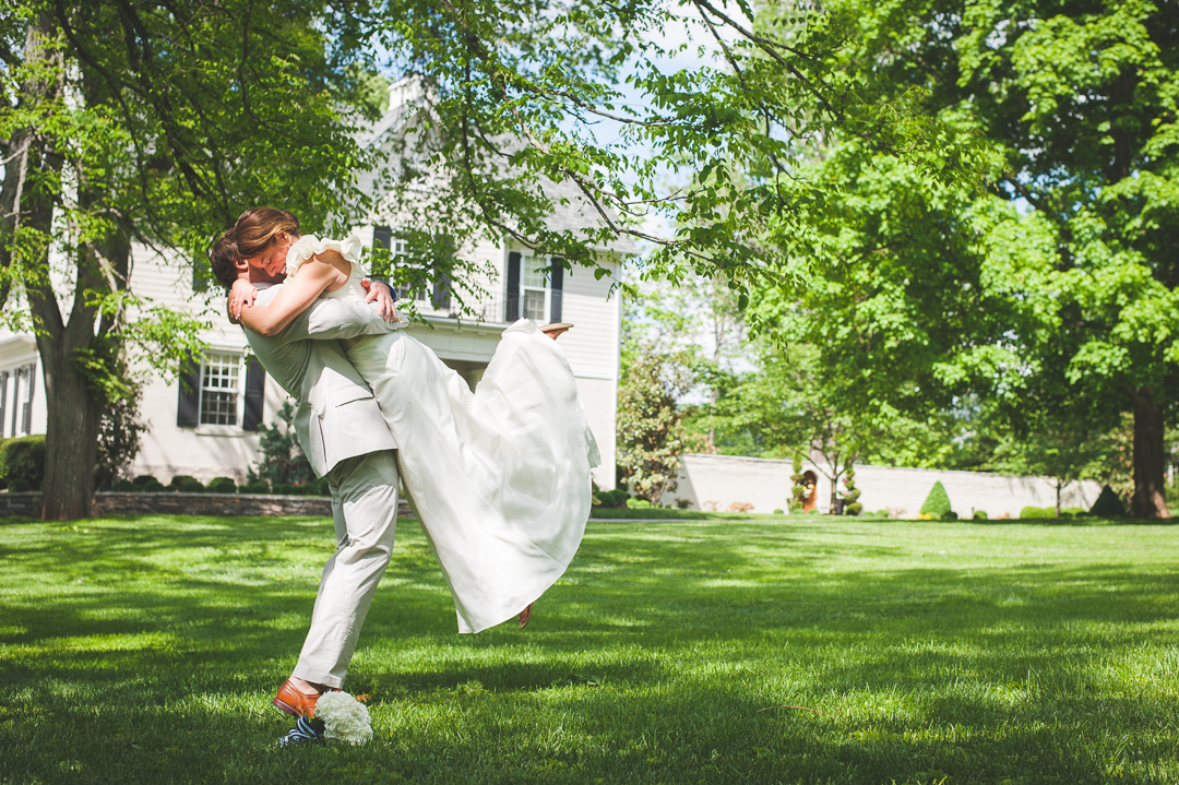 excitement between a southern bride and her groom during pre-ceremony photos