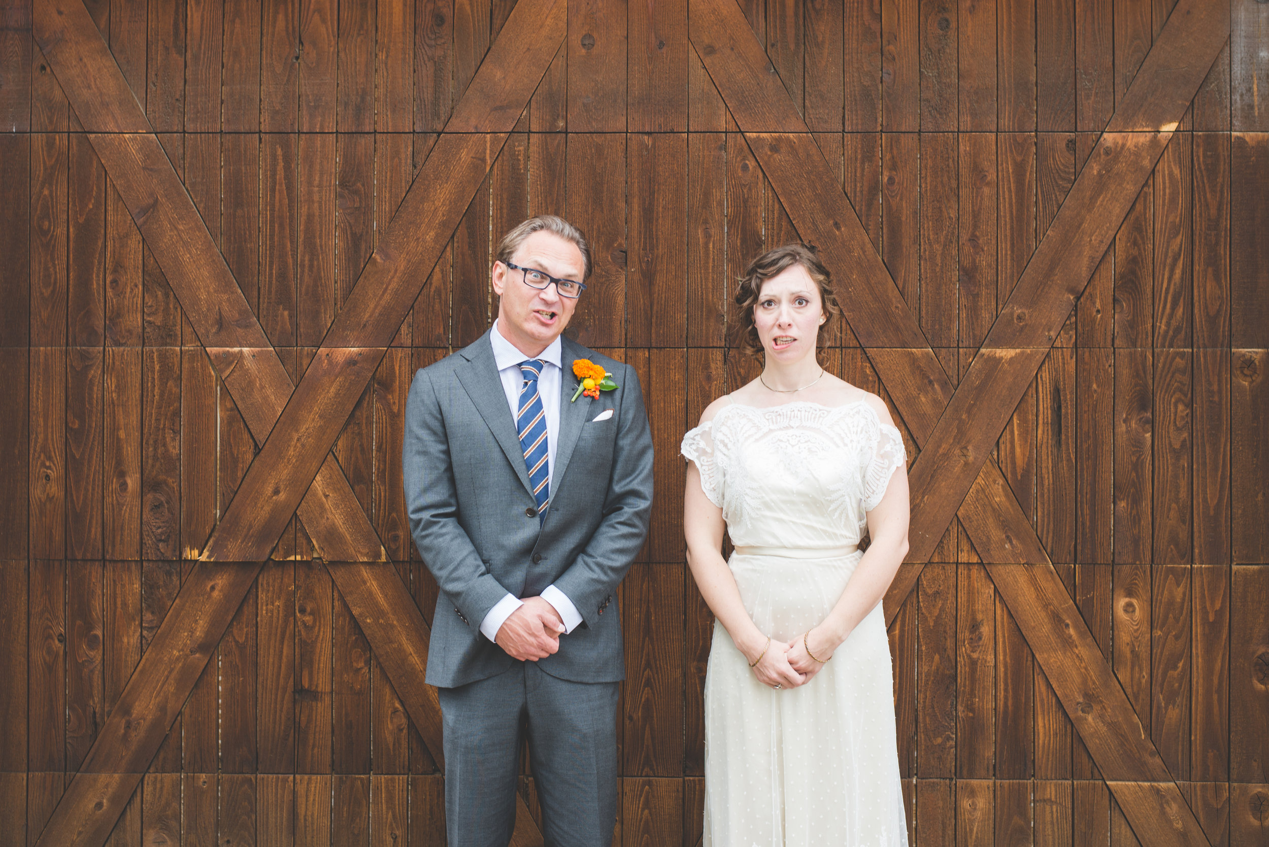 colorado bride and groom are asked to make a silly face during their photo shoot - they made the same face!