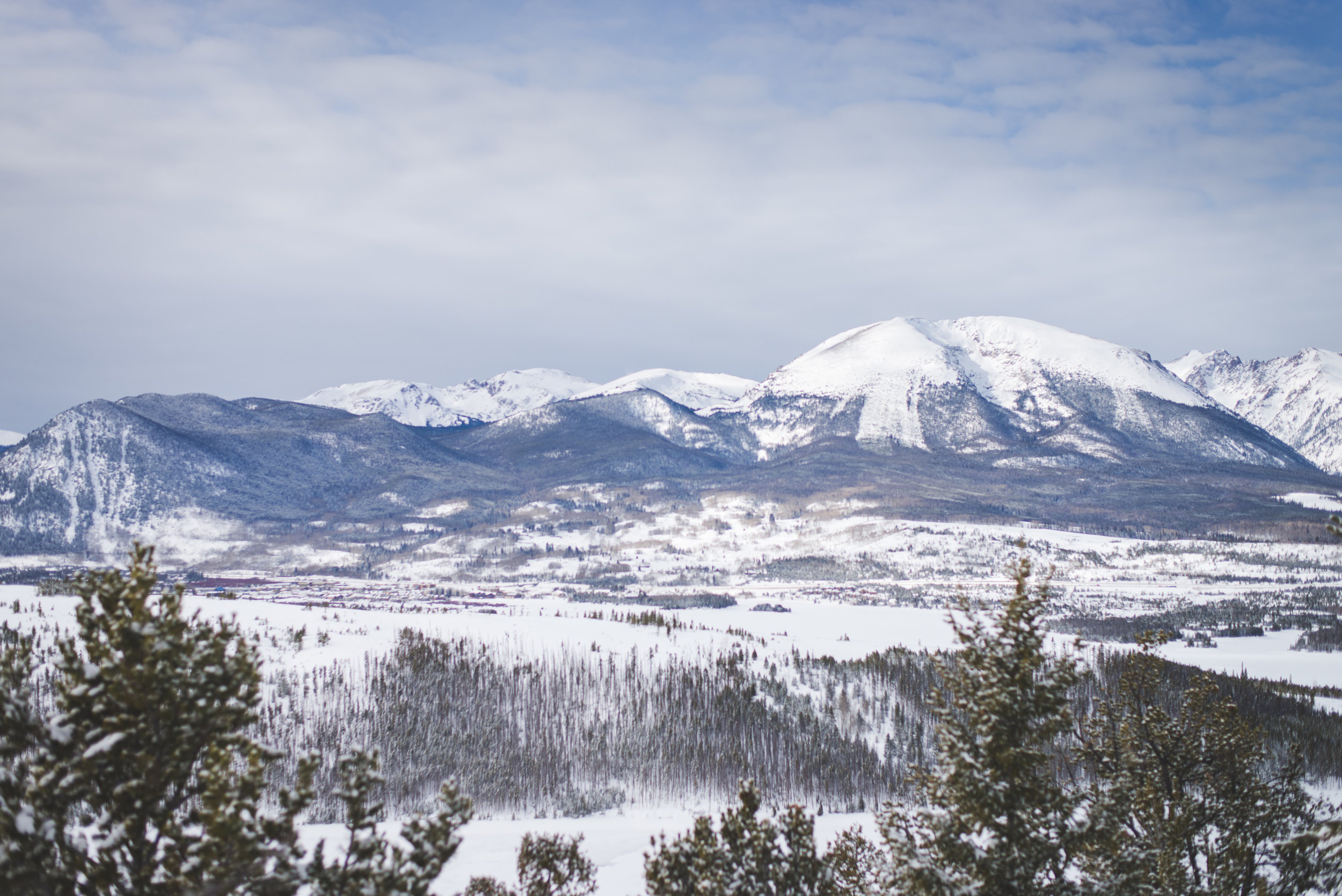 Buffalo Mountain towers over a frozen Lake Dillon in Summit County, Colorado in the winter