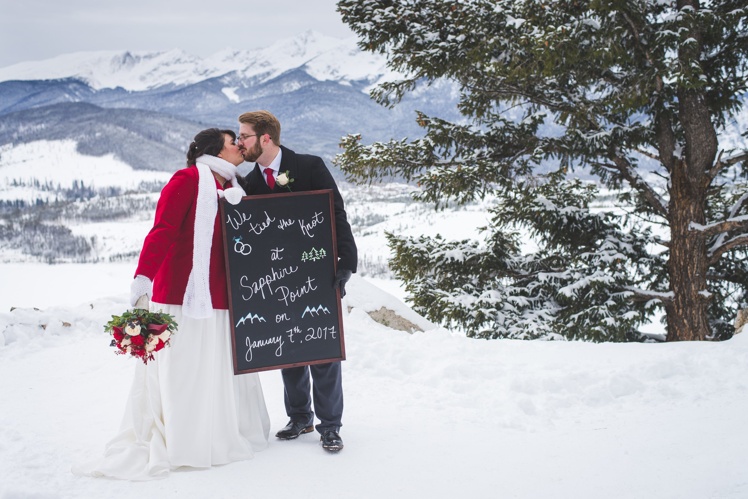 What a sweet chalkboard sign (and amazing view!) commemorating this couple's destination elopement in the Colorado mountains!