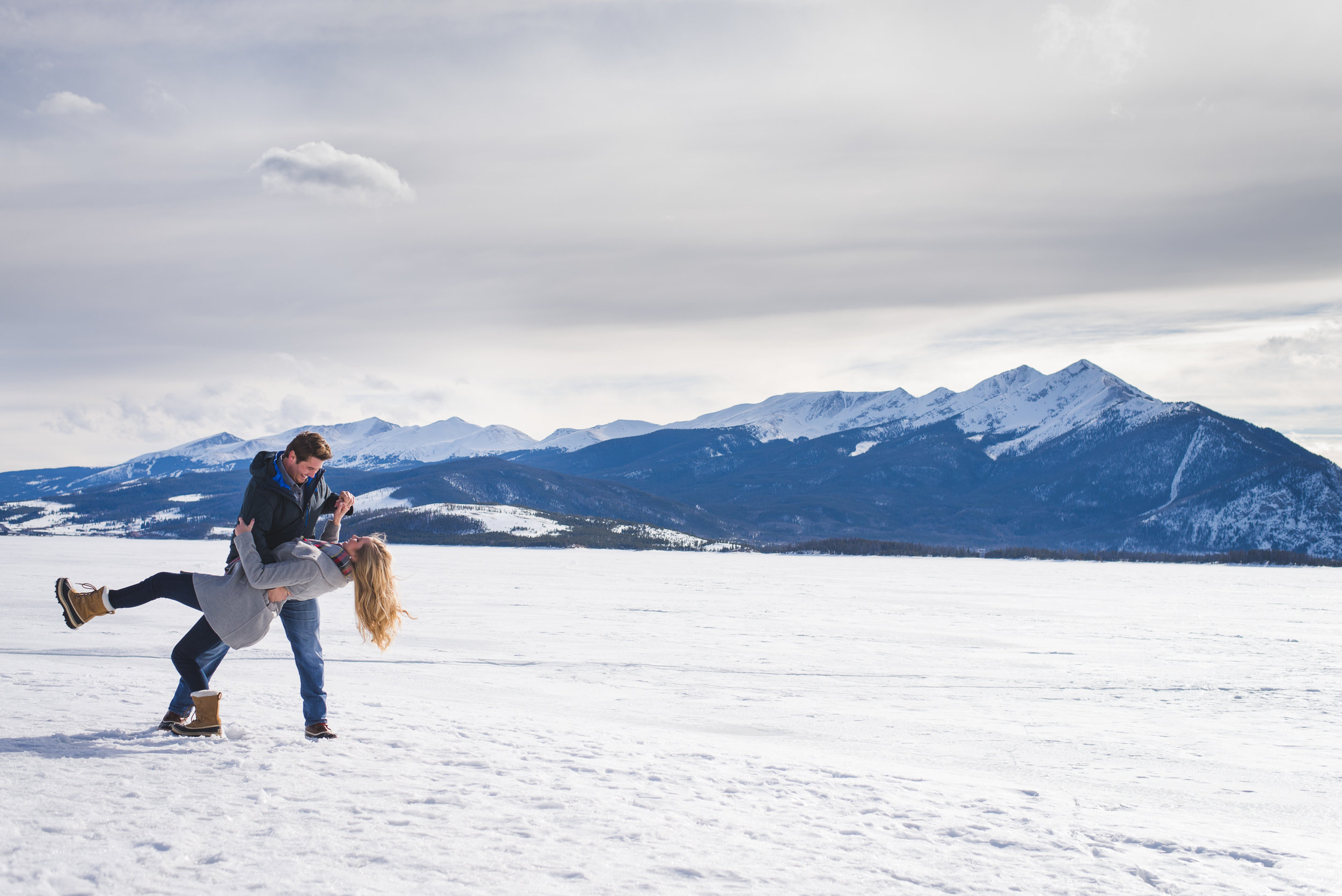 Winter Colorado destination engagement photo session on frozen Lake Dillon | Peak One and Buffalo Mountain | Keeping Composure Photography