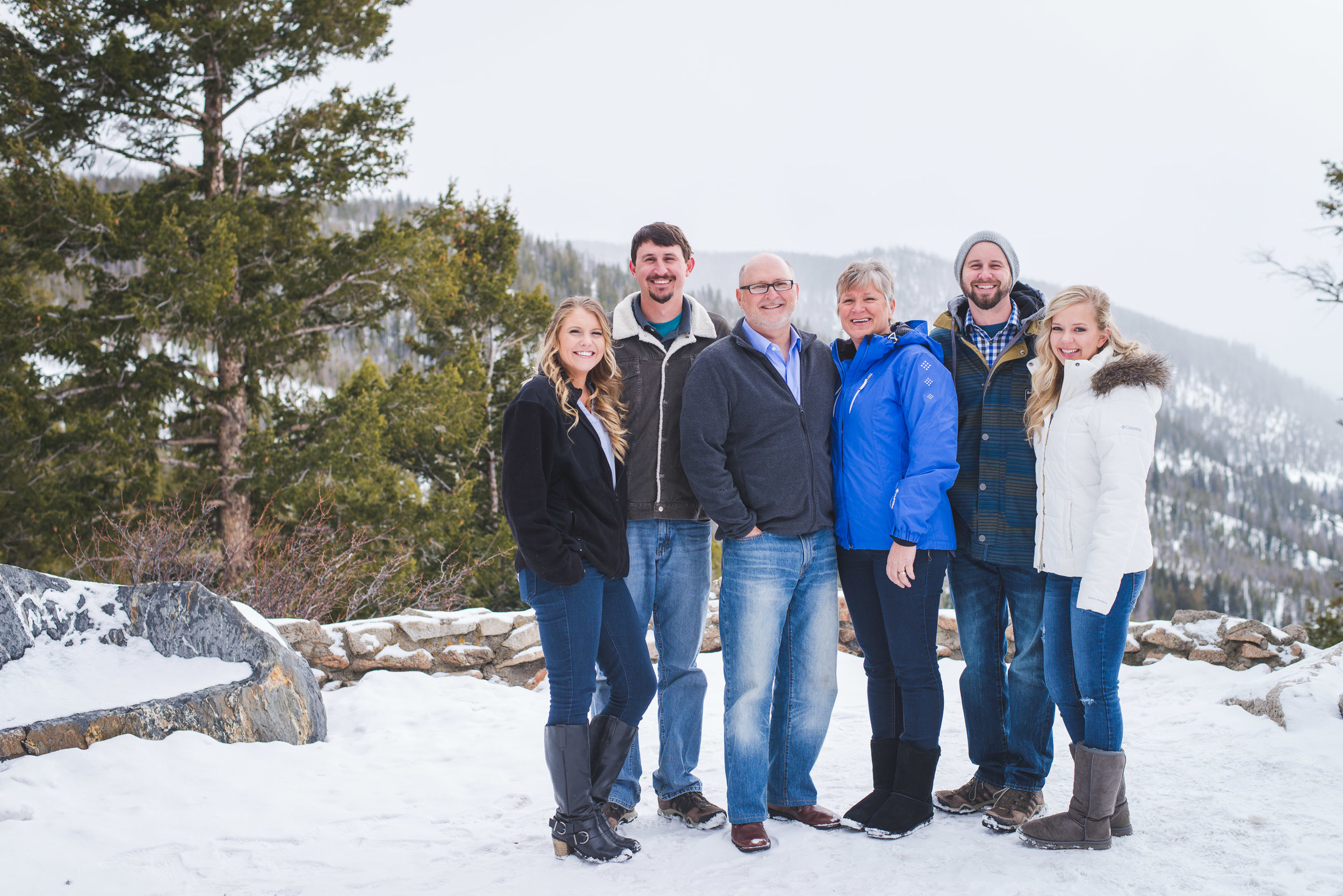 Surprise winter proposal at Sapphire Point in the Colorado mountains during a destination family photo shoot. | Keeping Composure Photography
