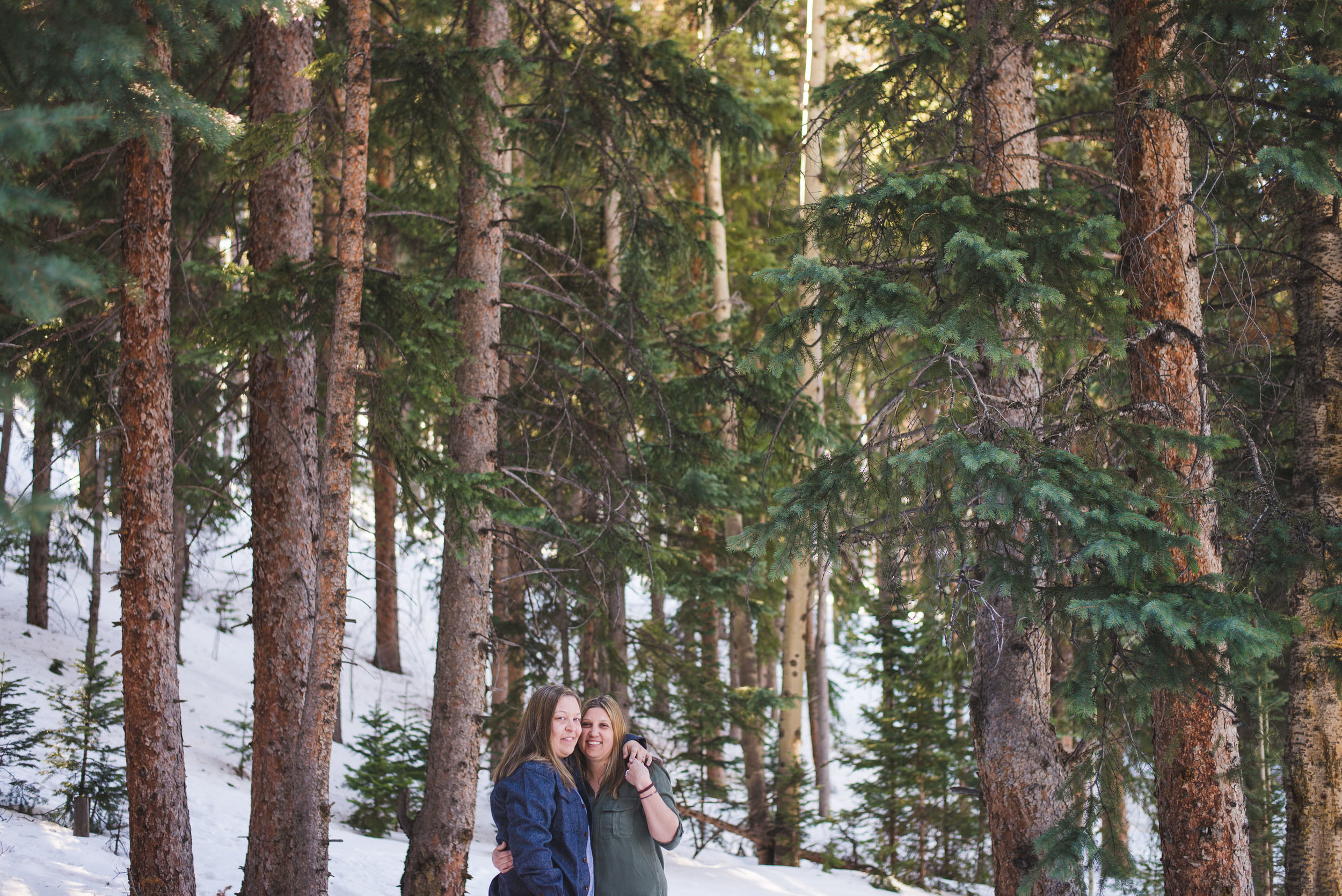 two women celebrate their upcoming winter wedding in Breckenridge, Colorado with a casual engagement photo session | Keeping Composure Photography