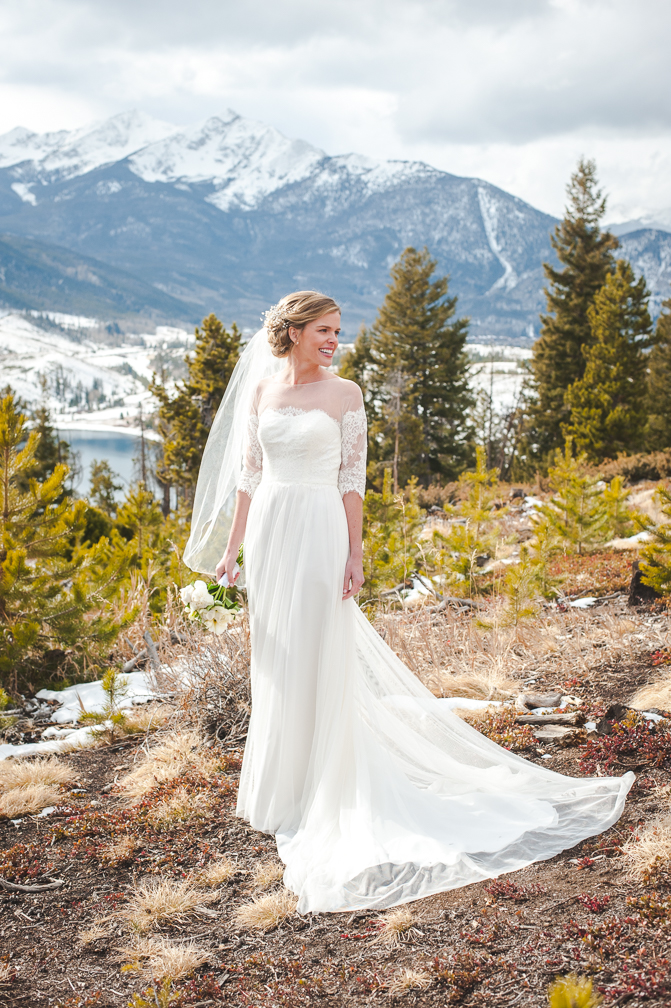 Colorado winter bride at Sapphire Point with Peak One in the background, near Breckenridge, Colorado | Keeping Composure Photography