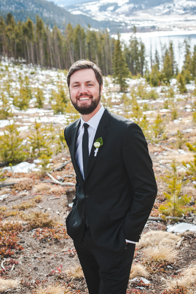 Colorado winter groom at Sapphire Point with Breckenridge in the background | Keeping Composure Photography