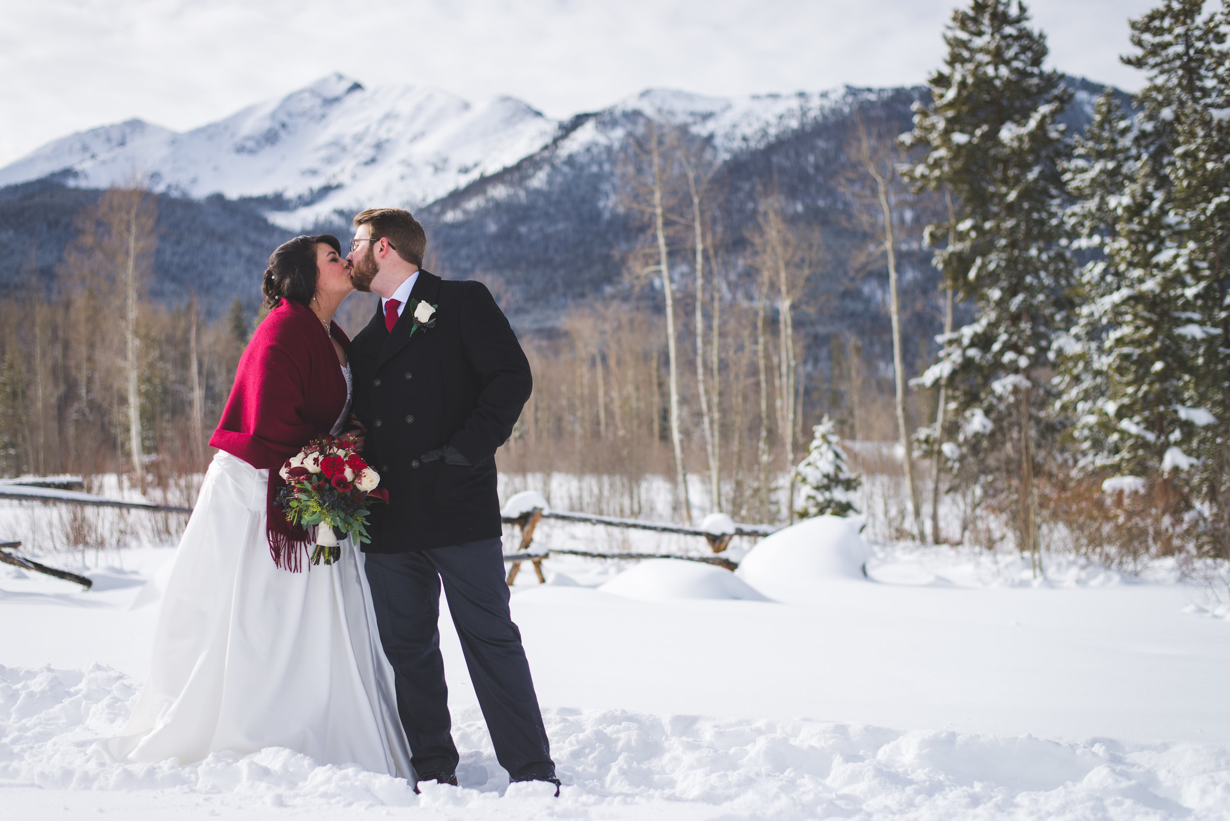 - {DEVYN + PHILIP}Philip and I cannot thank you enough for all of the gorgeous photos you captured on our special day! We sincerely appreciated you standing knee-deep in snow + being outside in the cold for our dream Colorado wedding! You are an absolute rock star!