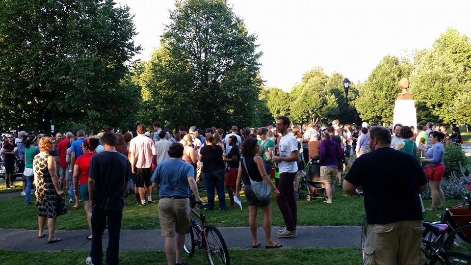 A crowd gathers outside of Symphony Circle to speak out against the recent wave of sexual assaults in the Queen City.  The protest drew over 200 concerned residents.  Photo by Giovanni Centuriore.