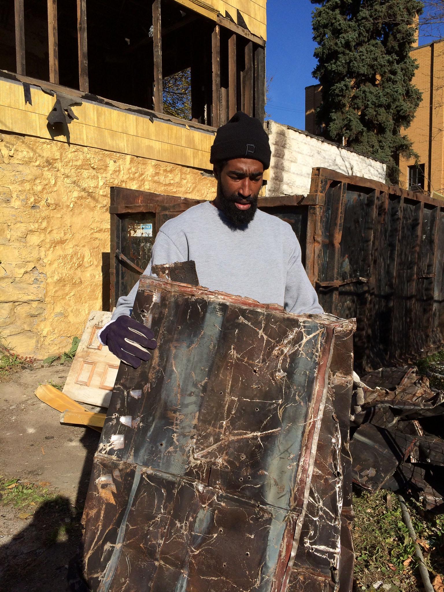 Howard folding up the tin roof.