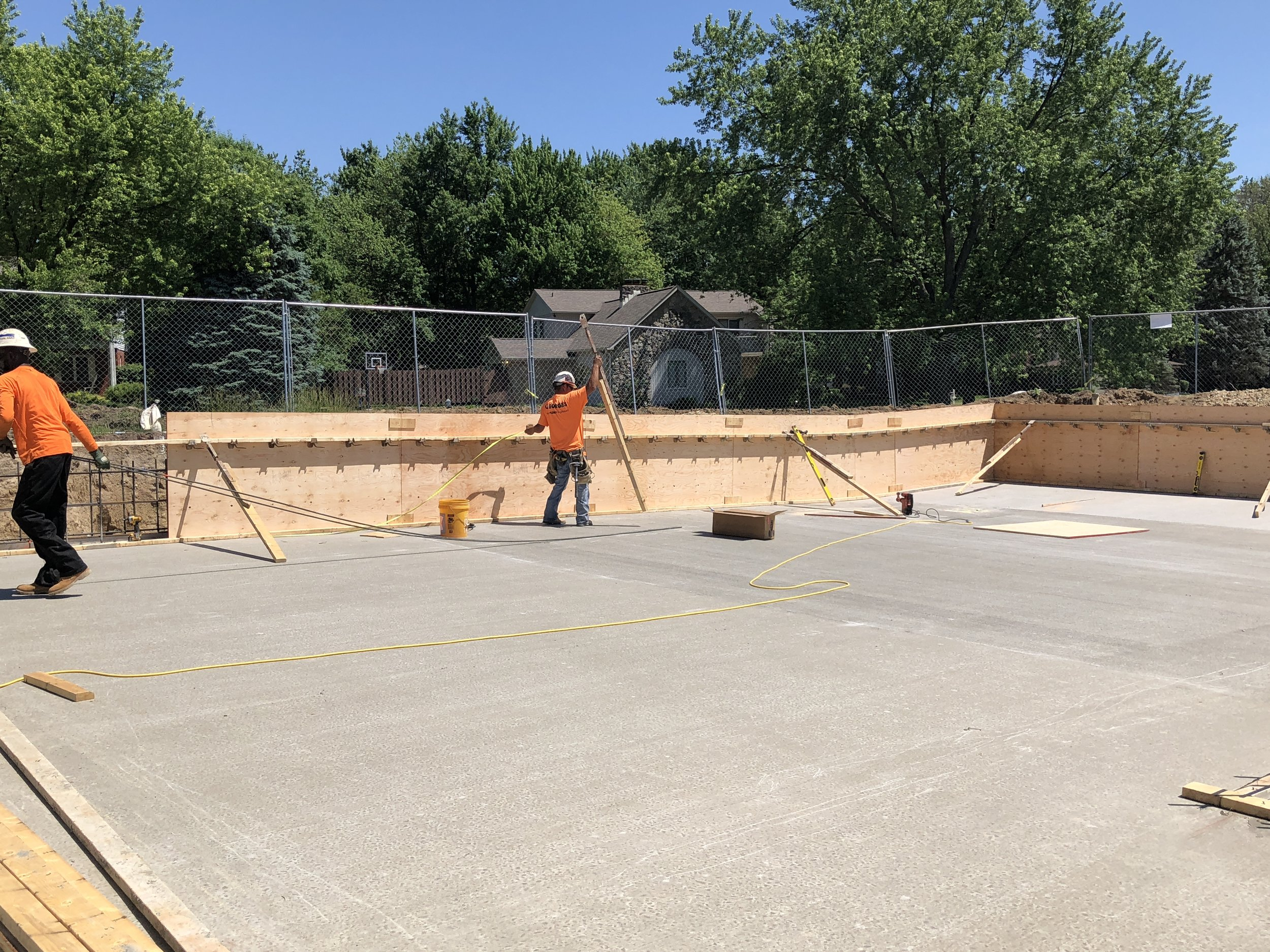 building the forms for the pool sidewalls . . .walls should be poured in the next two weeks - First week of June