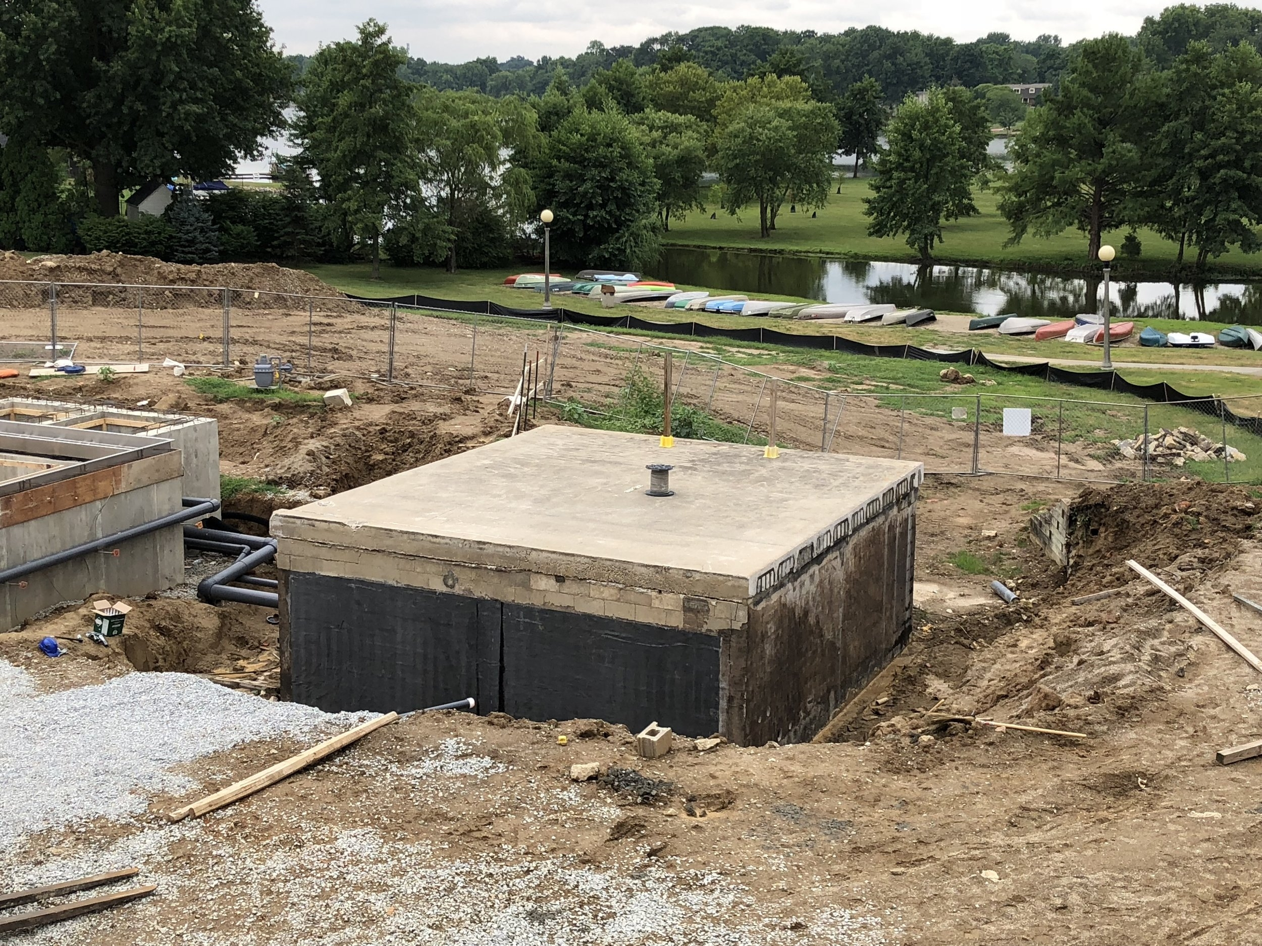 Pool Mechanical Room Walls have been reinforced and repaired. Awaiting the application of the waterproof membrane to side walls, then backfilling will take place once that is completed, construction will begin on the wading pool. (Update, Membrane was installed on 7/26.