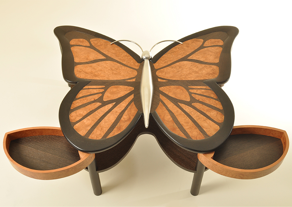 Another view of Adam Pierce's low butterfly table. Adam suspended two pivoting drawers onto the front legs for hidden storage.