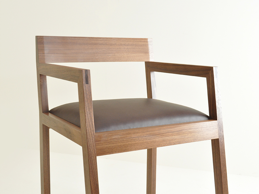 Damian Robinson's chair made in solid American Black Walnut. This chair accompanies the desk Damian made - also in American Black Walnut with a leather desk top.