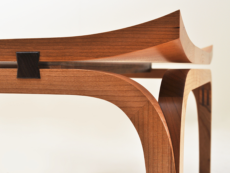 Detail view of Henry Baltesz' Cherry and Walnut Bundai table. The legs of Henry's table are mitred together, and the table top corners are hand shaped into a flair characterisic of Japanese architecture.