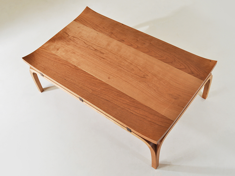 Top view of Henry Baltesz' Cherry and Walnut Bundai table. The legs of Henry's table are mitred together, and the table top corners are hand shaped into a flair characteristic of Japanese architecture.