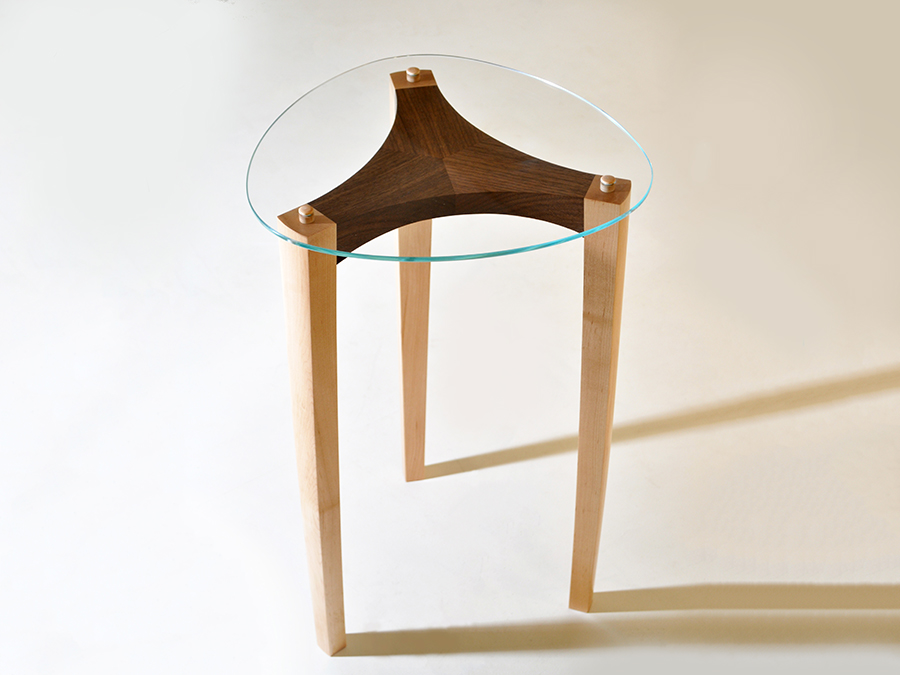 Maurice Vanderlinden's Black Walnut and Maple occasional table, with shaped glass surface.